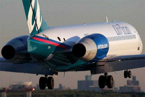 File photo of AirTran 717 N938AT about to touch down at LaGuardia. Photo by Phil Derner