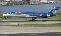 Midwest Airlines Boeing 717-2BL N902ME touches down on LaGuardia Airport Runway 31