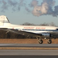 Now THAT is how you introduce a new runway! Charlotte's new runway 36L/18R receives its first rubber from this gorgeous DC-3. (Photo by Jay Selman/www.AirlinersGallery.com)