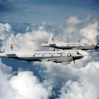 The P-3 Orion still is kicking butt with two feet, whether it's fight forest fires or flying through hurriances (above).