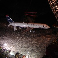 USAirways-1549_lifting_out_of_Hudson