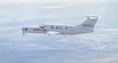 Hustler 400 in flight.
