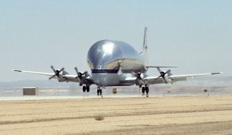 NASA's B377SGT Super Guppy Turbine cargo aircraft touches down at Edwards Air Force Base, Calif. on June 11, 2000 to deliver the latest version of the X-38 flight test vehicle to NASA's Dryden Flight Research Center. (Photo by NASA)