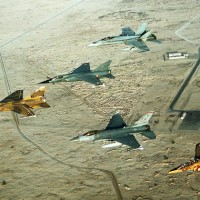 Coalition aircraft in formation over Saudi Arabia during Operation Desert Shield. From left to right: Qatari F-1 Mirage, French F-1C Mirage, US Air Force F-16C Fighting Falcon, Canadian CF/A-18A Hornet and Qatari Alpha Jet. (Photo by US Air Force/Staff Sgt. Lee Corkran)