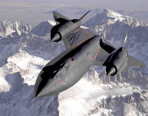 An SR-71B Blackbird, NASA 831, slices across the snow-covered southern Sierra Nevada Mountains of California after being refueled by an Air Force tanker during a 1994 flight. SR-71B was the trainer version of the SR-71. Notice the dual cockpit to allow the instructor to fly the airplane. (Photo by NASA)