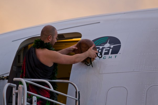 A native Hawaiian christens the plane with a coconut. (Photo by Lyle Jansma)