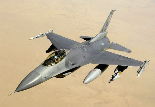 A U.S. Air Force Block 40 F-16 Fighting Falcon aircraft returns to the fight after receiving fuel from a KC-135 Stratotanker aircraft during a mission over Iraq on June 10, 2008