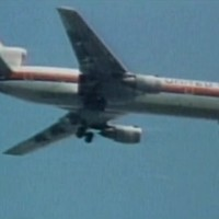 United Flight 232 on final descent, with visible damage to its tail.