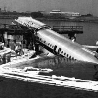 USAir Flight 5050 crashed at the end of La Guardia Airport's runway 31 after a rejected takeoff, killing 2.