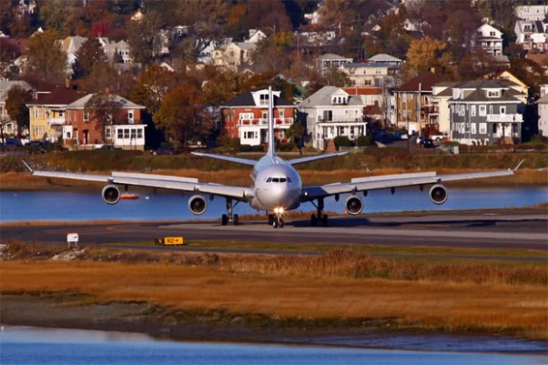 Some houses facing Boston Logan Airport get a face full of jet blast as an Air France Airbus A340-300 taxis off the runway after landing