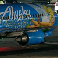 Tinkerbell actually twinkles as the Alaska Airlines Magic of Disneyland 737-400 taxis at LAX