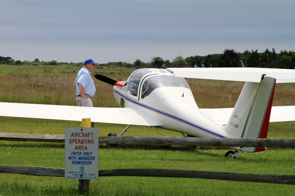 A Burkhart Grob glider (N404DW) basks in the sun at Katama Airpark, Marthas Vineyard, Mass. (Photo by Matt Molnar)