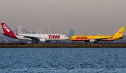 TAM Airbus A330 lined up to depart JFK as a DHL Boeing 767 taxis to the runway