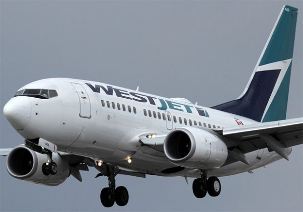 A baby WestJet Boeing 737-600 (C-GWSB) on final approach to Toronto Pearson International Airport. (Photo by Kaz T)