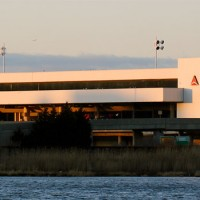 Delta's Terminal D at LaGuardia Airport (shown) will soon be joined to the adjacent Terminal C, currently occupied by US Airways. (Photo by Matt Molnar)