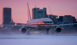 American 757 braving dusty snow in Boston. (Photo by Ron Stella)