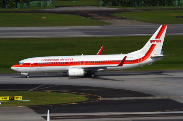 The retro liveried Garuda Indonesian Airways Boeing 737-800 PK-GFM taxis at Singapore