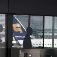 Reflection of an Icelandair Boeing 757 in an Amsterdam Schiphol window.