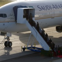 Saudi and Boeing officials climb aboard the new plane, Boeing 777-300ER HZ-AK11