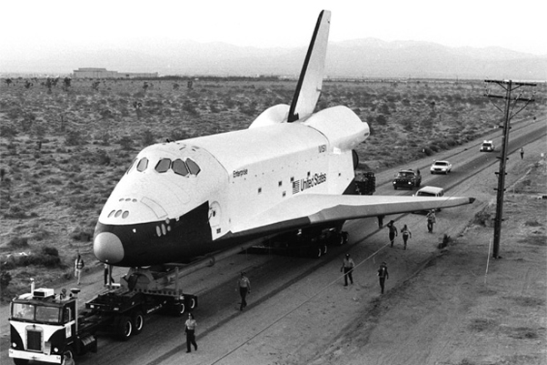 Space Shuttle Enterprise being trucked to Edwards Air Force Base in California.