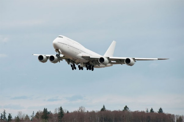 first Boeing 747-8 Intercontinental A7-HHE takes off on its delivery flight.