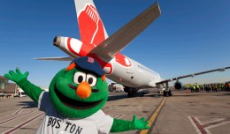 Wally the Green Monster poses with JetBlue's new Red Sox ship, Airbus A320 tail number 605 (N605JB). (Photo by JetBlue)