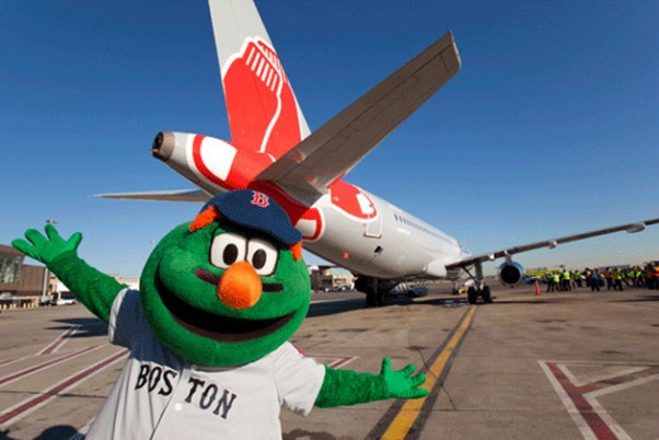 Wally the Green Monster poses with JetBlue&#039;s new Red Sox ship, Airbus A320 tail number 605 (N605JB). (Photo by JetBlue)