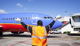 A Southwest ramper directs one of the first of the airline&#039;s planes to land in Atlanta
