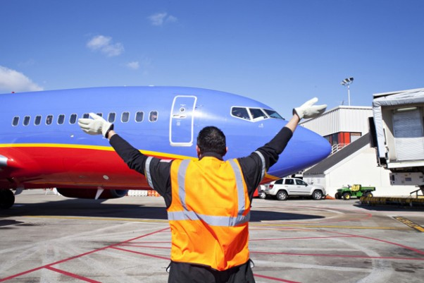 A Southwest ramper directs one of the first of the airline's planes to land in Atlanta