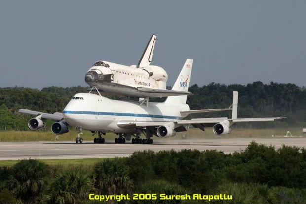 NASA Shuttle Carrier Aircraft N905NA with Space Shuttle Discovery during a return to KSC in 2005 after STS-114. The final flight of Discovery in April 2012 will look almost identical. Picture taken from the Air Traffic Control Tower at the midpoint of the Shuttle Landing Facility.