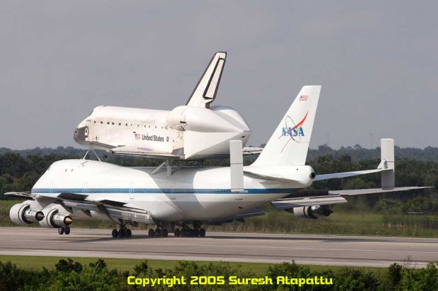 NASA Shuttle Carrier Aircraft N905NA with Space Shuttle Discovery during a return to KSC in 2005 after STS-114. Discovery's tail cone is installed just like it will be on her final flight. Picture taken from the Air Traffic Control Tower at the midpoint of the Shuttle Landing Facility. (Photo by Suresh A. Atapattu/WWW.ATAPATTU.NET)