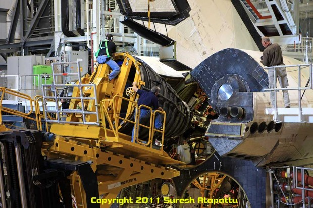 Space shuttle engine technicians carry out the install of the replica exhaust nozzles on Discovery. (Photo by Suresh A. Atapattu/WWW.ATAPATTU.NET)