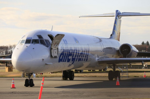 An Allegiant Air MD-83 sits cordoned off at Paine Field after making an emergency landing. (Photo by Dave King)