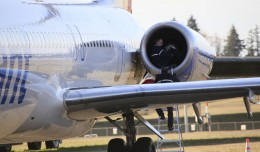 A technician examines the left engine of an Allegiant Air MD-83 at Paine Field, Wash., after it made an emergency landing.