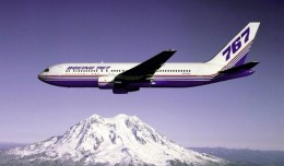 The Boeing 767 prototype (N767BA) flies over Washington's Mt. Rainier.