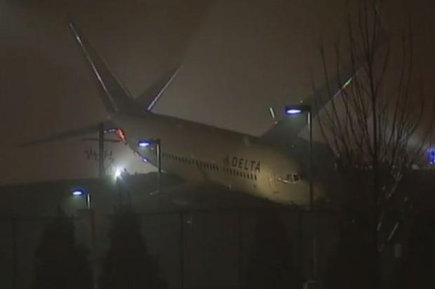 Delta Boeing 737-700 N309DE rests on a hillside at Hartsfield-Jackson Atlanta International Airport.