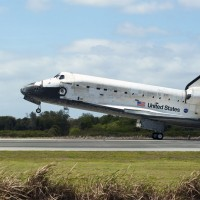 Space Shuttle Discovery touches down on Runway 15 at the Shuttle Landing Facility at NASA&#039;s Kennedy Space Center in Florida, concluding its 39th and final mission