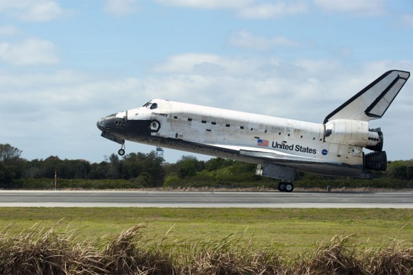 Space Shuttle Discovery touches down on Runway 15 at the Shuttle Landing Facility at NASA's Kennedy Space Center in Florida, concluding its 39th and final mission