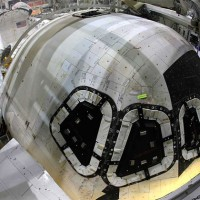 Space Shuttle Discovery while being prepped for display at the Smithsonian. (Photo by Suresh Attapatu)