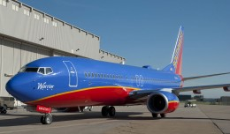 Southwest's first Boeing 737-800 N8301J Warrior One, taxis to its welcoming party.