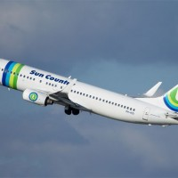 One of the more interesting deals in the airline business involves Minnesota-based Sun Country and Amsterdam-based Transavia, who swap airplanes during their respective slow seasons. Right now it's Sun Country's turn, operating this Boeing 737-800 (PH-HZI) out of Minneapolis in a hybrid Transavia livery. (Photo by Doug Lambert)