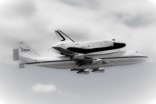 Space Shuttle Enterprise and the Shuttler Carrier 747 flyby JFK Airport. (Photo by Eric Dunetz)