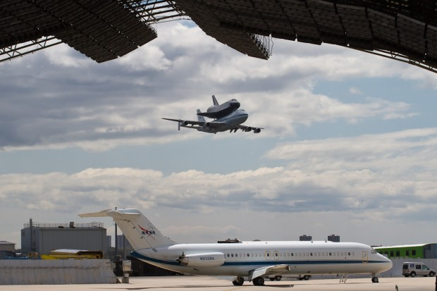 Shuttle Enterprise does a flyby at JFK, the NASA DC-9 already on the ground. (Photo by Eric Dunetz)
