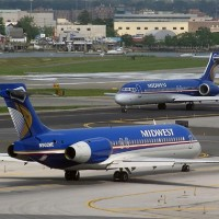 Two Midwest Airlines Boeing 717s, N902ME and sister ship N904ME, taxiing to their gates at LaGuardia Airport. (Photo by Ron Peel)