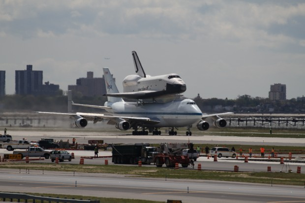 Space Shuttle Enterprise and the Shuttle Carrier Aircraft land at JFK Airport. (Photo by Fred Miler)