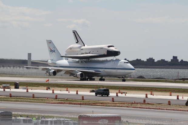 Space Shuttle Enterprise and the Shuttle Carrier Aircraft land at JFK Airport. (Photo by Fred Miller)