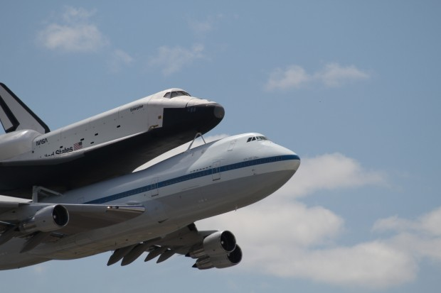Enterprise and the Shuttle Carrier Aircraft flyby JFK Airport. (Photo by Fred Miler)