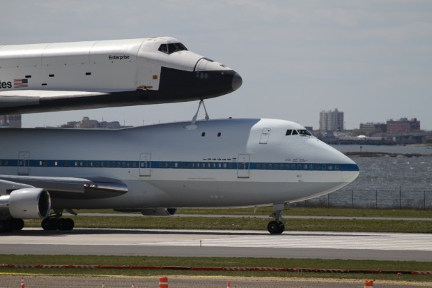 Space Shuttle Enterprise and the Shuttle Carrier Aircraft roll out after landing at JFK. (Photo by Fred Miller)