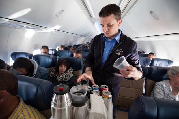 A Southwest flight attendant serves drinks from a new beverage cart aboard a 737-800 flight. (Photo by Stephen H. Keller/Southwest Airlines)