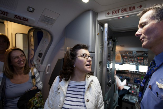 Passengers are greeted by a Southwest flight attendant. (Photo by Stephen M. Keller/Southwest Airlines)